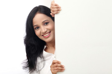 happy business woman showing blank signboard