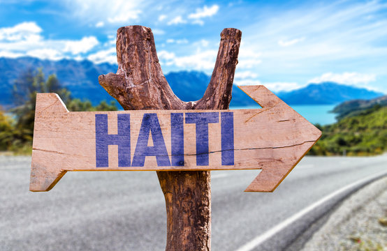 Haiti wooden sign with road background