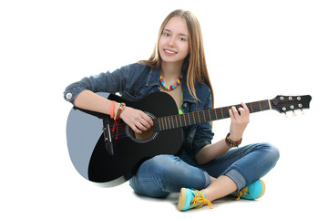 young girl teenager with a guitar