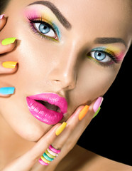 Foto op Canvas Beauty Beauty girl face with vivid makeup and colorful nail polish