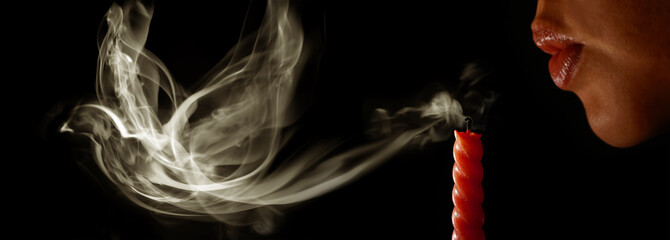 Woman blows out a candle and the smoke becomes to a bird