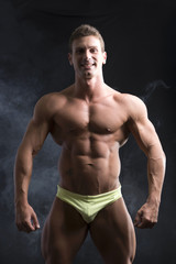Muscular smiling shirtless young man in underwear