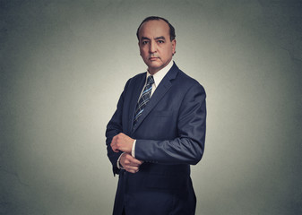 Portrait of a serious businessman on gray background