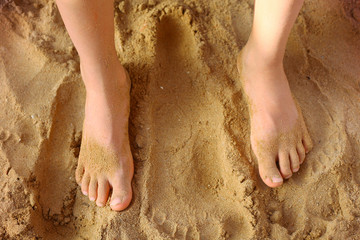 kids foot on the beach sand as a therapy against patypodia