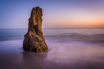 Sea stack in the Pacific Ocean at sunset, at El Matador State Be