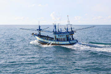 thailand local fishery boat running over blue sea water