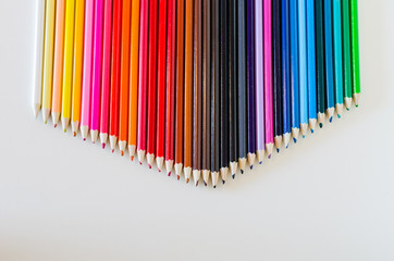 Brightly Colored Pencil Crayons Grouped Together Into a Point Ac