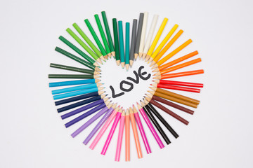 Colored pencils frame heart shaped