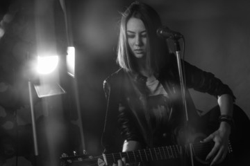 the girl playing guitar in the Studio