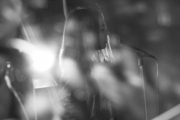 girl singing into a microphone in a studio