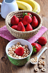 Healthy breakfast with strawberries, bananas and cereal