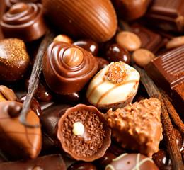 Chocolates background. Praline chocolate sweets