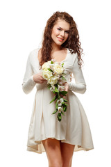 Young happy bride in white short dress with a bouquet of flowers