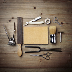 Set of vintage barber shop tools with blank kraft paper
