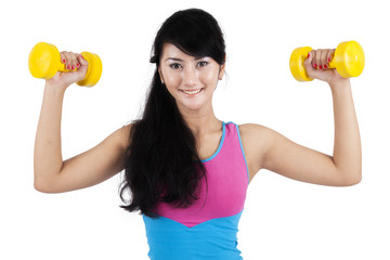 Attractive woman workout with dumbbells