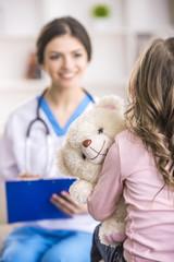 Little girl in a doctor