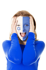 Woman with Israel flag on face.