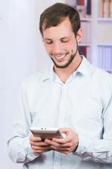 smiling handsome man using tablet
