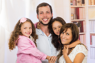 Sweet family with two little girls posing