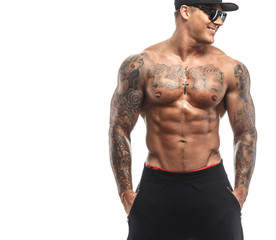 Brutal male with tattooed torso
