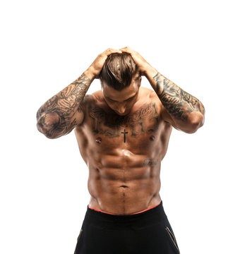 Muscular guy with tattooed body