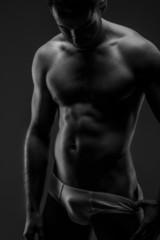 Man in panties posing on gray background