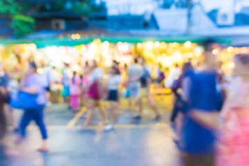 Blur tourists walk in shopping market
