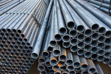 Metal pipes are stored in a warehouse