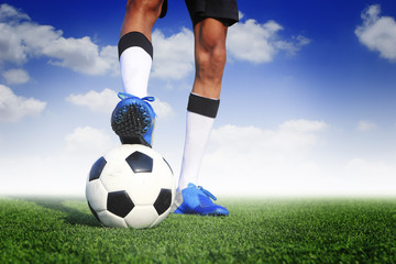 soccer ball with feet player on the football field