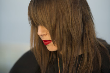 Long hair and red lipstick