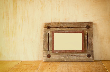 Photo of old nautical wooden frame on wooden table