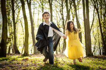 boy with cape and girl in princess dress