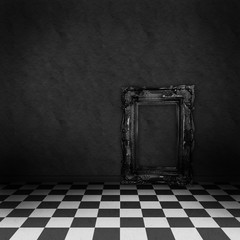 Room with black and white checker floor and empty frame