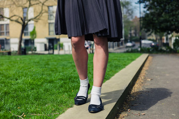 Woman wearing a skirt walking in park