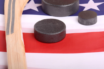 Hockey equipment including a stick and puck on an American flag