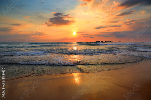 Wall mural landscape with sea sunset on beach