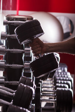 Gym equipment. Sport background. Dumbbell. Copy space