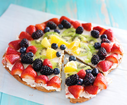 colorful fruit pizza with berries and cream cheese