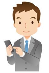 スマートフォンからメールを送るビジネスマン