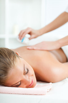 Young woman relaxing on spa treatment
