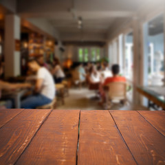 Empty table and blurred people in cafe background, product displ