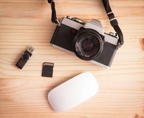 Retro vintage old photo camera with pendrive, sd card and mouse