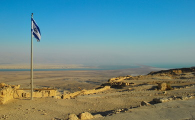 Israeli flag on wall of  fortress of Masada in Israel