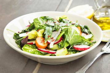 Vegetables Salad Dish with Fresh Organic Lettuce,Radish, Carrots