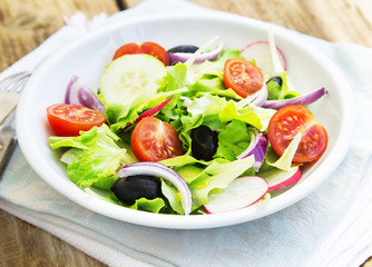 Vegetables Salad Dish with Fresh Organic Lettuce,Tomatoes,Olives
