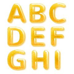Yellow honey jelly alphabet. Glossy letters.