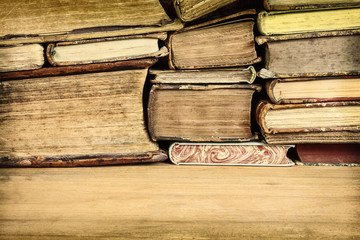 Sepia toned image of old books on a table