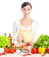 Smiling woman preparing salad.