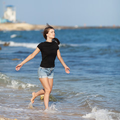 Attractive girl at the sea