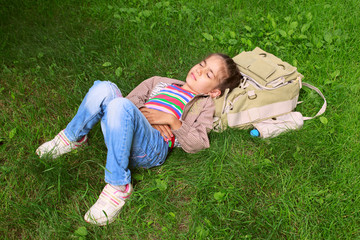 Little beautiful girl child kid sleeping on grass